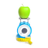 Weighing an apple Royalty Free Stock Photo
