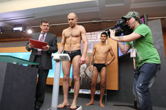 Weighing boxers on press conference Royalty Free Stock Photography