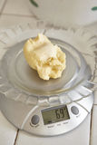 Weighing bread dough. Using electronic scales Royalty Free Stock Photos