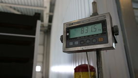 Weighing cargo after unloading for storage in warehouses. Russia, Novosibirsk - July 25, 2015: Transport company weigh cargo after unloading a trailer truck for stock footage