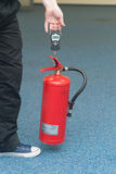 Weighing extinguisher Royalty Free Stock Photo