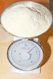 Weighing flour. In the kitchen royalty free stock photography