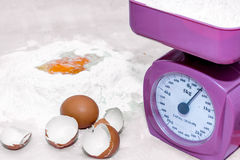 Weighing flour on a kitchen scale Royalty Free Stock Photos