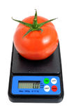 Weighing food. Weigh his food for a diet Royalty Free Stock Images