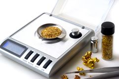 Weighing of gold Stock Image