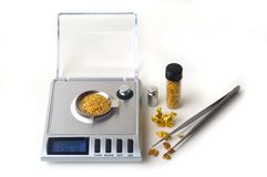 Weighing of gold Royalty Free Stock Photo