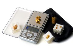 Weighing of gold Stock Photography