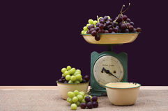 Weighing grapes on vintage scales. Stock Photo