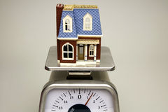Weighing House Values Royalty Free Stock Photography