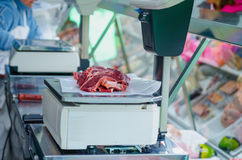 Weighing raw meat Stock Photo