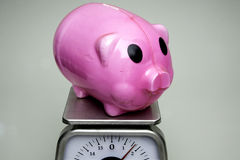 Weighing Savings Royalty Free Stock Photos