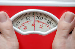 Weighing scale. Weighing yourself on a weighing scale Stock Photography