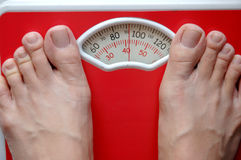 Weighing scale. Weighing yourself on a weighing scale Royalty Free Stock Images