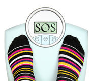Weighing scale. Woman s feet on weighing scale Royalty Free Stock Images
