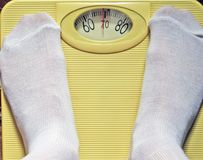 Weighing in a scale Stock Images