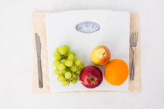 Weighing scales with fruits Royalty Free Stock Photo