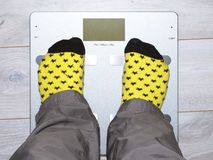 Weighing scales, weight, feet, socks, health Royalty Free Stock Image