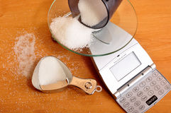 Weighing sugar on scale. Photo of weighing sugar on scale stock photography