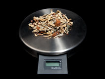 Weighing things Out. A small scale with a pile of magic mushrooms on it Royalty Free Stock Photos
