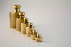 Weight 1. Still life with brass weight royalty free stock image