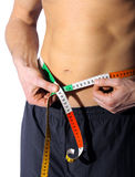 Weight. Male abdomen with tape wrapped around the body Royalty Free Stock Photos