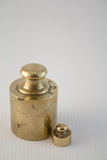 Weight 3. Still life with brass weight stock images