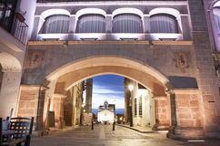 Weight Arch illuminated by led lights, Spain. Hight square of Badajoz,  illuminated by led lights at twilight. Arco del Peso or Weight Arch Royalty Free Stock Photos