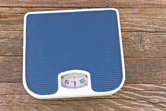Weight bathroom scale on wooden floor Royalty Free Stock Photos