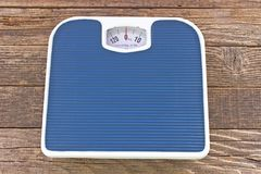 Weight bathroom scale on wooden floor Stock Images