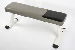 Weight bench. Gray, white, and black weight bench on white background Royalty Free Stock Photo