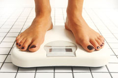 Weight checking Royalty Free Stock Photo
