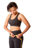 Weight conscious woman Royalty Free Stock Photography