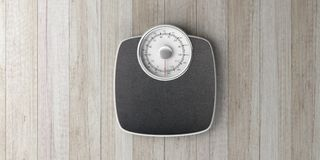 Weighing scale isolated on wooden background. 3d illustration. Weight control concept. Bathroom scale isolated on wooden background, top view, banner. 3d Royalty Free Stock Photos