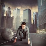 Weight of disadvantage. Man stuck in a challenge by an obstacle Stock Images