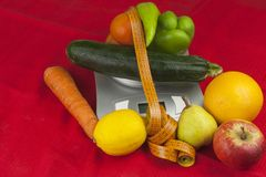The weight of food, preparing food while dieting. Healthy homemade food. Fruits and vegetables Royalty Free Stock Image