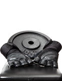 Weight and gloves on a bench. 10kg weight and fitness gloves on a black leather bench Royalty Free Stock Image