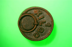 Weight iron,wtwo rusty iron weightseight iron on green background Royalty Free Stock Images