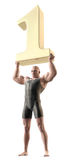Weight lifter. A muscular man in a body suit lifting a giant gold number 1 over his head Royalty Free Stock Image