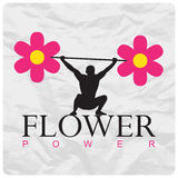 Weight lifter and flowers. Royalty Free Stock Photography