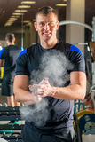 Weight lifter in the gym preparing arms against sliding Royalty Free Stock Photo