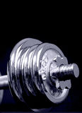 Weight lifting. Weights on a bar for lifting Royalty Free Stock Photo