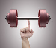 Weight Lifting. With just one finger. Concept of strength and training Stock Image