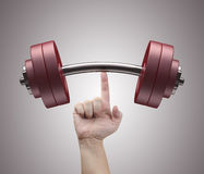 Weight Lifting. With just one finger. Concept of strength and training Stock Photos