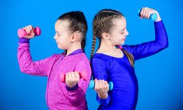 Weight lifting for bodycare muscules. Childhood bodycare. Fitness diet for energy health. Happy children with barbell stock photography