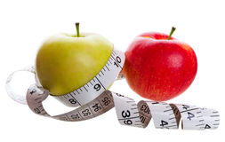 Weight Lose. Healthy eating and weight lose conceptual image.  Shot on white background Royalty Free Stock Image