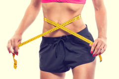 Weight losing - measuring woman's body Stock Photo