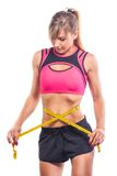 Weight losing - measuring woman's body Royalty Free Stock Image