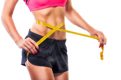 Weight losing - measuring woman's body Royalty Free Stock Photos