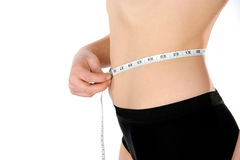 Weight Loss. Woman measuring her  waist on white background Stock Photos