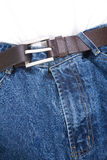 Weight loss. A blue jean and belt, concept of weight loss stock image